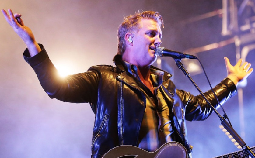 Queens Of The Stone Age frontman apologises after kicking photographer
